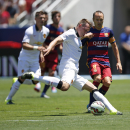 Manchester United's Phil Jones kicks the ball as Andres Iniesta defends FC Barcelona's during an International Champions Cup soccer match at Levi's Stadium, Saturday, June 25, 2015, in Santa Clara, Calif. (Terrell Lloyd/AP Images for Relevent