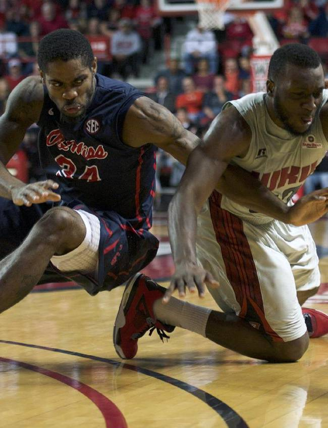 Western Kentucky guard T.J. Price (52) fights for possession with Mississippi forward Aaron Jones (34) during an NCAA men's college basketball game, Monday, Dec. 30, 2013, in Bowling Green, Ky. Mississippi won 79-74