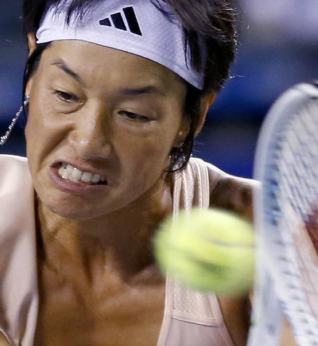 Kimiko Date-Krumm of Japan returns a shot to Victoria Azarenka of Belarus during their first round match of the Japan Pan Pacific Open tennis tournament in Tokyo,Tuesday, Sept. 16, 2014