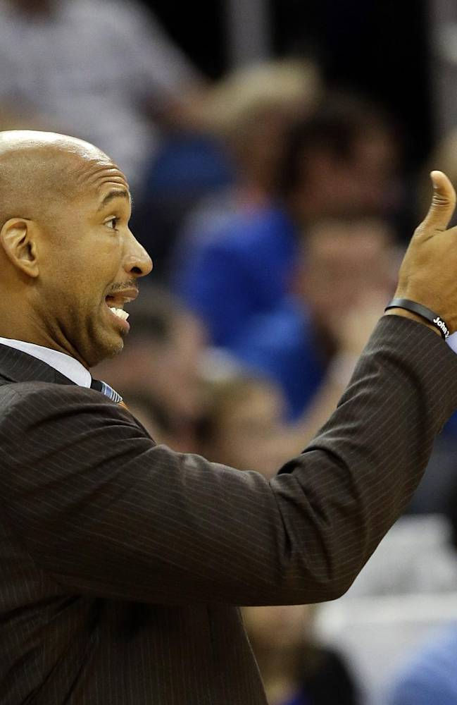 New Orleans Pelicans head coach Monty Williams shouts instructions to his players during the first half of an NBA basketball game against the Orlando Magic in Orlando, Fla., Friday, Nov. 1, 2013