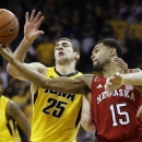 Nebraska's Ray Gallegos, right, looks to grab a rebound in front of Iowa's Eric May (25) during the second half of an NCAA college basketball game, Saturday, March 9, 2013, in Iowa City, Iowa. Iowa won 74-60. (AP Photo/Charlie Neibergall)