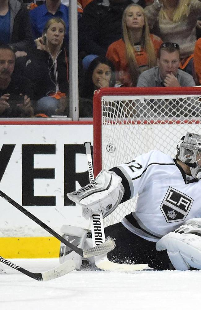 Anaheim Ducks left wing Patrick Maroon, left, scores on Los Angeles Kings goalie Jonathan Quick during the first period in Game 2 of an NHL hockey second-round Stanley Cup playoff series, Monday, May 5, 2014, in Anaheim, Calif