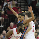 Houston Rockets center Omer Asik, 3, sets a pick on Oklahoma City Thunder guard Andre Roberson, center, for teammate James Harden during an NBA basketball game in Houston Friday, April 4, 2014 The Associated Press