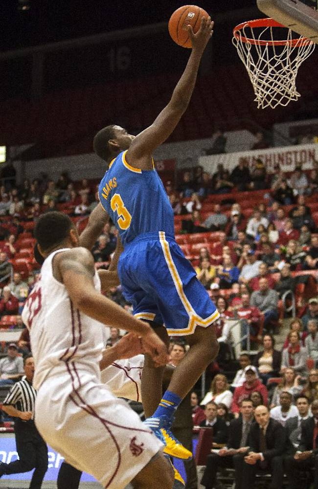 UCLA guard Jordan Adams (3) puts in a layup to finish a fast break against Washington State during the first half of an NCAA college basketball game Saturday, March 8, 2014, at Beasley Coliseum in Pullman, Wash