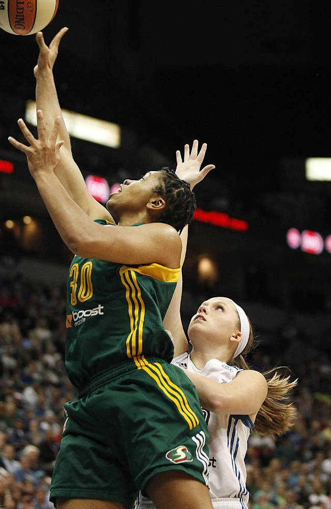 Seattle Storm guard Tanisha Wright (30) goes up to the basket against Minnesota Lynx guard Lindsey Moore, center, in the opening game of a first-round WNBA basketball playoff series, Friday, Sept. 20, 2013, in Minneapolis. The Lynx won 80-64
