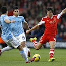 Southampton's Jack Cork, right, vies for the ball with Manchester City's Samir Nasri, left, and Sergio Aguero, center, during the English Premier League soccer match between Southampton and Manchester City at St Mary's Stadium in Southampton, England Sat