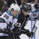 San Jose Sharks center Logan Couture (39) and Los Angeles Kings right wing Dustin Brown (23) fight for the puck during the th