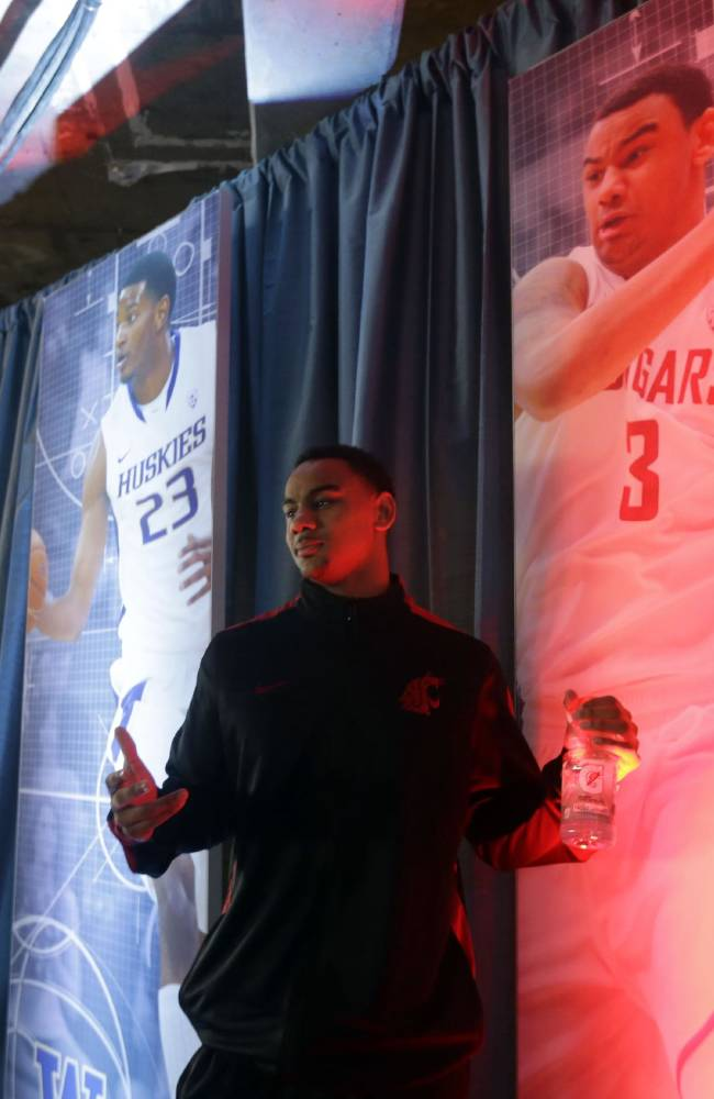 Washington State's Davonte Lacy poses for a picture next to a mural bearing his likeness during the Pac-12 NCAA college basketball media day on Thursday, Oct. 17, 2013, in San Francisco