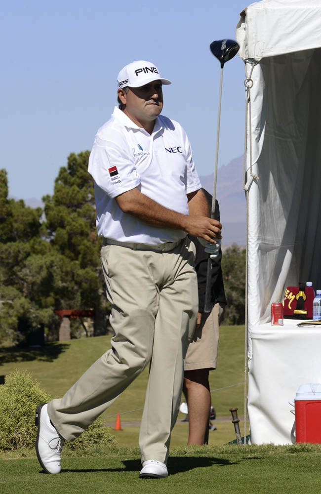 In this photo provided by the Las Vegas News Bureau, Angel Cabrera watches a tee shot during the pro-am of the Shriners Hospitals for Children Open golf tournament at TPC Summerlin in Las Vegas, Wednesday, Oct. 16, 2013