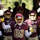 Washington Redskins wide receiver Santana Moss (89) and others, enter the field before during an NFL football game against the Tennessee Titans, Sunday, Oct. 19, 2014, in Landover, Md The Associated Press