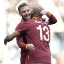 AS Roma defender Maicon, of Brazil, right, celebrates with his teammate Daniele De Rossi after he scored during a Serie A soccer match between AS Roma and Fiorentina, at Rome's Olympic Stadium, Sunday, Dec. 8, 2013. (AP Photo/Andrew Medichini)