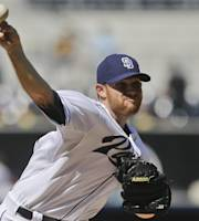 San Diego Padres starting pitcher Ian Kennedy throws against the Pittsburgh Pirates in the first inning of a baseball game on Wednesday, Aug. 21, 2013, in San Diego. (AP Photo/Lenny Ignelzi)
