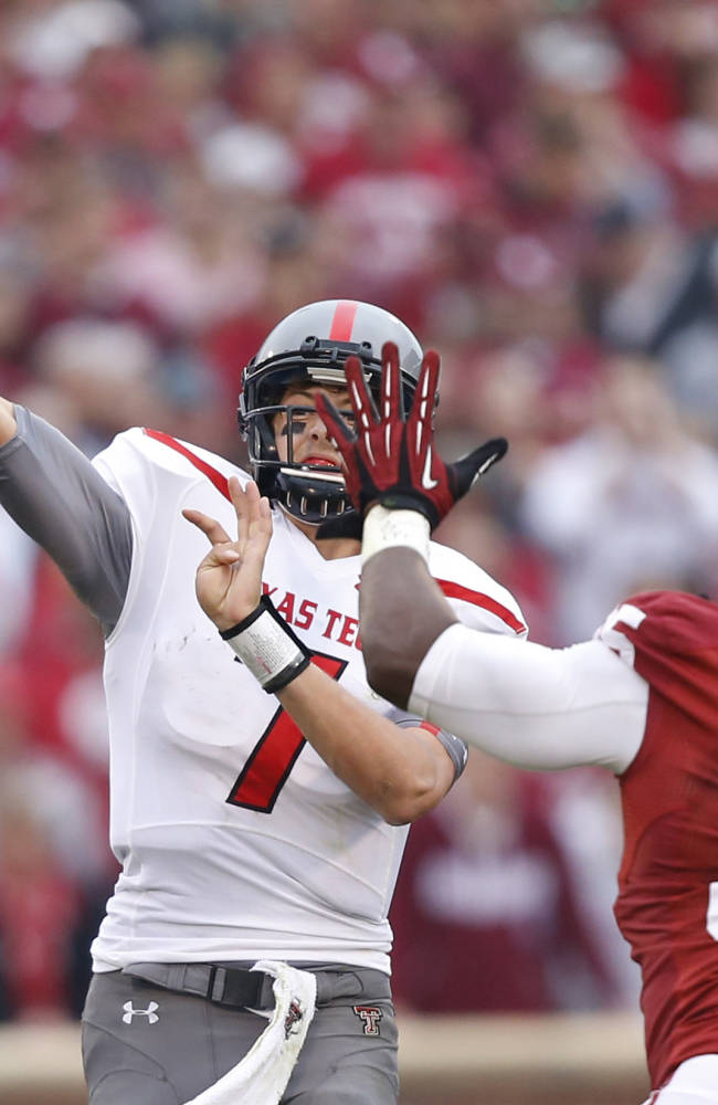 Texas Tech quarterback Davis Webb (7) passes under pressure from Oklahoma defensive end Geneo Grissom (85) in the first quarter of an NCAA college football game in Norman, Okla., Saturday, Oct. 26, 2013. Oklahoma won 38-30