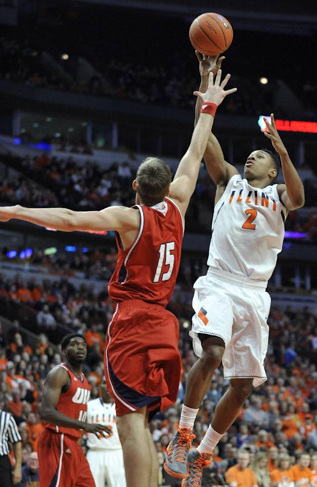 Illinois' Joseph Bertrand (2) goes up for a shot against Illinois-Chicago's Jordan Harks (15) during the first half of an NCAA college basketball game in Chicago, Saturday, Dec., 28, 2013
