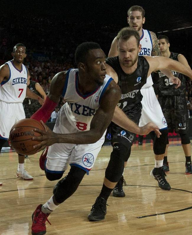 Philadelphia 76ers' Tony Wroten, centre left, duels for the ball in front Bilbao Basket's Antanas Kavaliauskas, centre right, during the NBA Global basketball game in Bilbao northern Spain on Sunday, Oct. 6, 2012