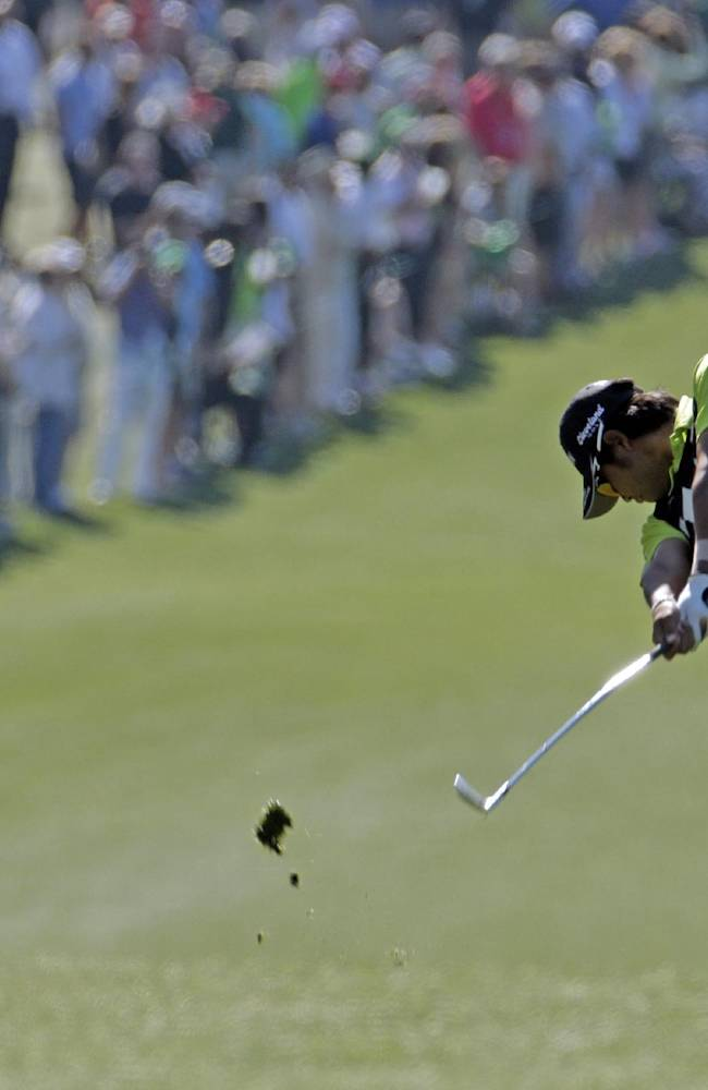 Hideki Matsuyama, of Japan, hits on the first fairway during the first round of the Masters golf tournament Thursday, April 10, 2014, in Augusta, Ga