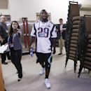New England Patriots running back LeGarrette Blount (29) is directed to his interview table as he arrives for a news conference Wednesday, Jan. 28, 2015, in Chandler, Ariz. The Patriots play the Seattle Seahawks in NFL football Super Bowl XLIX Sunday, Feb