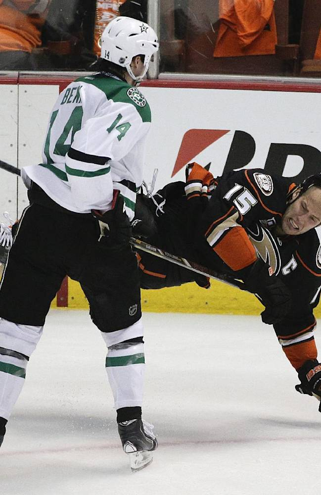 Dallas Stars' Jamie Benn(14) checks Anaheim Ducks' Ryan Getzlaf during the first period in Game 1 of the first-round NHL hockey Stanley Cup playoff series on Wednesday, April 16, 2014, in Anaheim, Calif