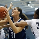 Connecticut's Stefanie Dolson (31) tries to shoot between Providence's Brianna Edwards (33) and Alexis Harris, left, in the first half of an NCAA college basketball game in Providence, R.I., Tuesday, Feb. 12, 2013. (AP Photo/Michael Dwyer)