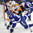 Tampa Bay Lightning center Vladislav Namestnikov (90), of Russia, is knocked down by Philadelphia Flyers defenseman Luke Schenn (22) during the second period of an NHL hockey game Thursday, Oct. 30, 2014, in Tampa, Fla The Associated Press