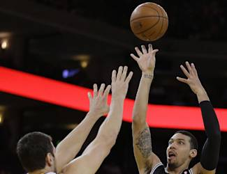 San Antonio Spurs' Danny Green (4) shoots over Golden State Warriors' Andrew Bogut (12) during the first half of an NBA basketball game, Thursday, Dec. 19, 2013, in Oakland, Calif. (AP Photo/Ben Margot)