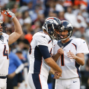 Denver Broncos kicker Connor Barth, right, is greeted by teammate long snapper Aaron Brewer, center, after kicking a 49-yard field goal against the San Diego Chargers as teammate punter Britton Colquitt, left, reacts during the second half of an NFL footb