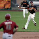 San Francisco Giants shortstop Brandon Hicks, right, makes the throw to first in time to get the out on Arizona Diamondbacks' Chris Owings, left, during the ninth inning of a spring exhibition baseball game on Sunday, March 2, 2014, in Scottsdale, Ariz Th