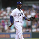 Los Angeles Dodgers' shortstop Hanley Ramirez dances during the second game of the two-game Major League Baseball opening series between the Los Angeles Dodgers and Arizona Diamondbacks at the Sydney Cricket ground in Sydney, Sunday, March 23, 2014 The As