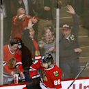 Chicago Blackhawks right wing Patrick Kane celebrates his goal, the 200th of his career, during the second period of an NHL hockey game against the Arizona Coyotes on Tuesday, Jan. 20, 2015, in Chicago The Associated Press