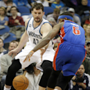 Detroit Pistons' Josh Smith, right, loses control of the ball momentarily as Minnesota Timberwolves' Kevin Love defends in the first quarter of an NBA basketball game, Friday, March 7, 2014, in Minneapolis The Associated Press