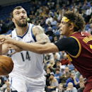 Cleveland Cavaliers' Anderson Varejao, right, of Brazil, knocks the ball away from Minnesota Timberwolves' Nikola Pekovic, of Montenegro, as he attempted a shot in the first quarter of an NBA basketball game Wednesday, Nov. 13, 2013, in Minneapolis The As