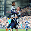 West Brom's Chris Brunt, right, celebrates with Stephane Sessegnon after he scored against Tottenham during the English Premier League soccer match between West Bromwich Albion and Tottenham Hotspur at The Hawthorns Stadium in West Bromwich, England, Satu
