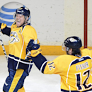 Nashville Predators forward Patric Hornqvist (27), of Sweden, celebrates with forward Mike Fisher (12) after Hornqvist scored the go ahead goal against the Tampa Bay Lightning in the third period of an NHL hockey game, Thursday, Feb. 27, 2014, in Nashvill