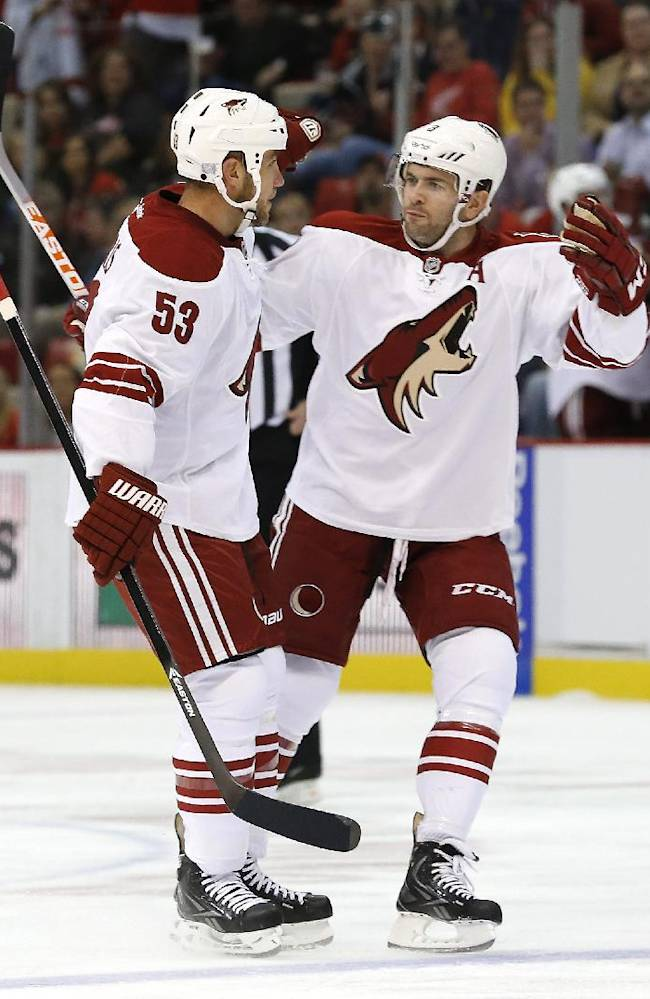 Phoenix Coyotes' Derek Morris (53) celebrates his goal against the Detroit Red Wings with Phoenix Coyotes Keith Yandle in the first period of an NHL hockey game in Detroit, Thursday, Oct. 10, 2013