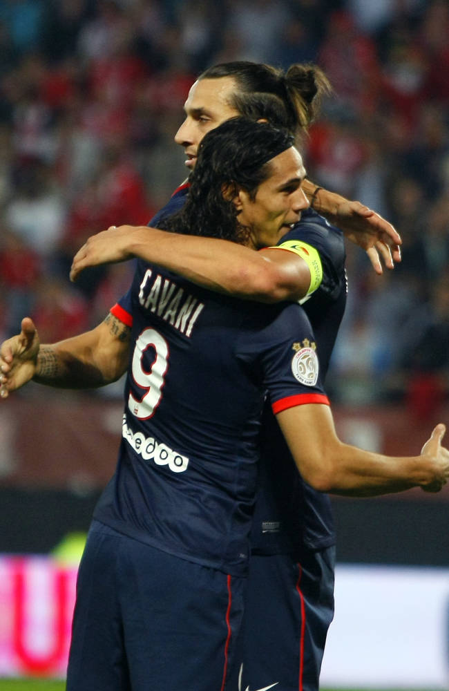 PSG's Edinson Cavani, front, celebrates with team-mate PSG's Zlatan Ibrahimovic  the first goal during his French League one soccer match, against Valenciennes, in Valenciennes, northern France, Wednesday, Sept. 25, 2013