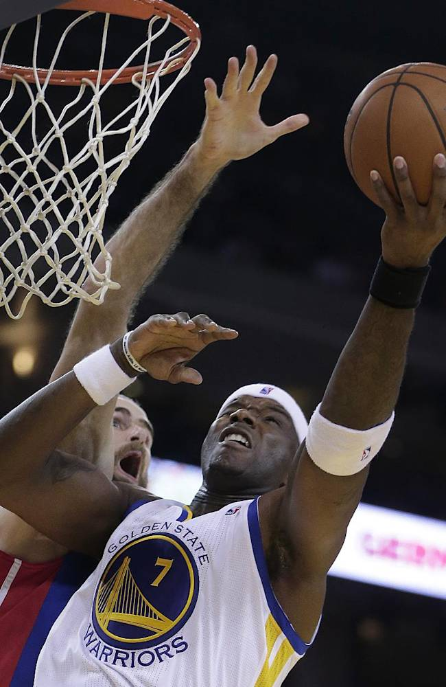 Golden State Warriors' Jermaine O'Neal, right, lays up a shot over Detroit Pistons' Luigi Datome during the second half of an NBA basketball game Tuesday, Nov. 12, 2013, in Oakland, Calif
