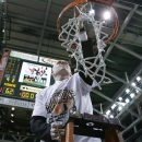 Miami coach Jim Larranaga cuts down the net after an NCAA college basketball game against Clemson in Coral Gables, Fla., Saturday, March 9, 2013. Kenny Kadji scored a season-high 23 points to help the sixth-ranked Hurricanes win the Atlantic Coast Conference championship outright by beating Clemson 62-49 . (AP Photo/J Pat Carter)