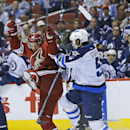 Phoenix Coyotes center Antoine Vermette (50) collides with Winnipeg Jets defenseman Mark Stuart (5) during the first period of an NHL hockey game Tuesday, April 1, 2014, in Glendale, Ariz The Associated Press