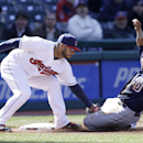 San Diego Padres' Everth Cabrera, right, is caught stealing third base as Cleveland Indians' Mike Aviles makes the tag in the third inning in the second game of a baseball doubleheader on Wednesday, April 9, 2014, in Cleveland The Associated Press