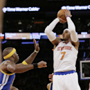 New York Knicks' Carmelo Anthony, right, shoots over Golden State Warriors' Jermaine O'Neal during the first half of an NBA basketball game on Friday, Feb. 28, 2014, in New York The Associated Press