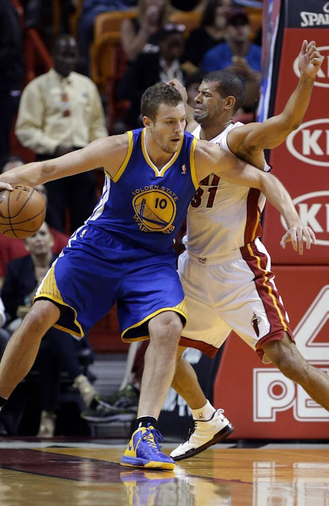 Golden State Warriors' David Lee (10) drives to the basket as Miami Heat's Shane Battier (31) defends during the first half of an NBA basketball game, Thursday, Jan. 2, 2014, in Miami