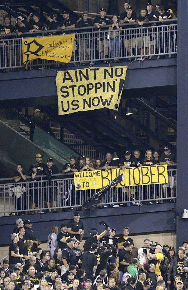 Banners supporting the Pittsburgh Pirates hang from the left field rotunda as the Pirates play the Cincinnati Reds in the NL wild-card playoff baseball game Tuesday, Oct. 1, 2013, in Pittsburgh