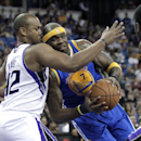 Golden State Warriors center Jermaine O'Neal, right, goes to the basket against Sacramento Kings forward Chuck Hayes during the first quarter of an NBA basketball game in Sacramento, Calif., Sunday, Dec. 1, 2013 The Associated Press