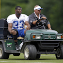 Indianapolis Colts running back Vick Ballard rides off the field on a cart after he was injured during the NFL team's football training camp in Anderson, Ind., Friday, July 25, 2014 The Associated Press