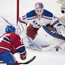 New York Rangers goaltender Cam Talbot makes a save against Montreal Canadiens' Tomas Plekanec during the second period of an NHL hockey game, Saturday, April 12, 2014, in Montreal The Associated Press