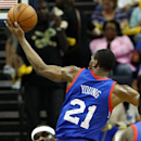 Memphis Grizzlies forward Zach Randolph, bottom, is fouled by Philadelphia 76ers forward Thaddeus Young (21) in the second half of an NBA basketball game on Friday, April 11, 2014, in Memphis, Tenn The Associated Press
