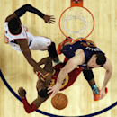 Team Hill's Miles Plumlee of the Phoenix Suns right, vies for a loose ball with Team Hill's Dion Waiters of the Cleveland Cavaliers, center, and Team Webber's Victor Oladipo of the Orlando Magic during the Rising Star NBA All Star Challenge Basketball gam