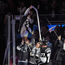 Los Angeles Kings center Jeff Carter, right, gives a stick to a young fan following an NHL hockey game against the Chicago Blackhawks, Wednesday, Jan. 28, 2015, in Los Angeles. The Kings won 4-3 The Associated Press