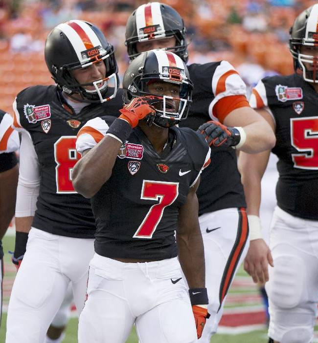 Oregon State wide receiver Brandin Cooks (7) celebrates with teammates after scoring a touchdown in the first quarter against Boise State in the Hawaii Bowl NCAA college football game in Honolulu, Tuesday, Dec. 24, 2013