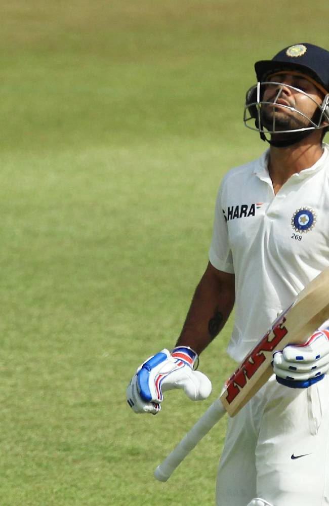 India's batsman Virat Kohli leaves the field after being dismissed by South Africa's bowler Morne Morkel, for 46 runs during the second day of their cricket test match at Kingsmead stadium, Durban, South Africa, Friday, Dec. 27, 2013